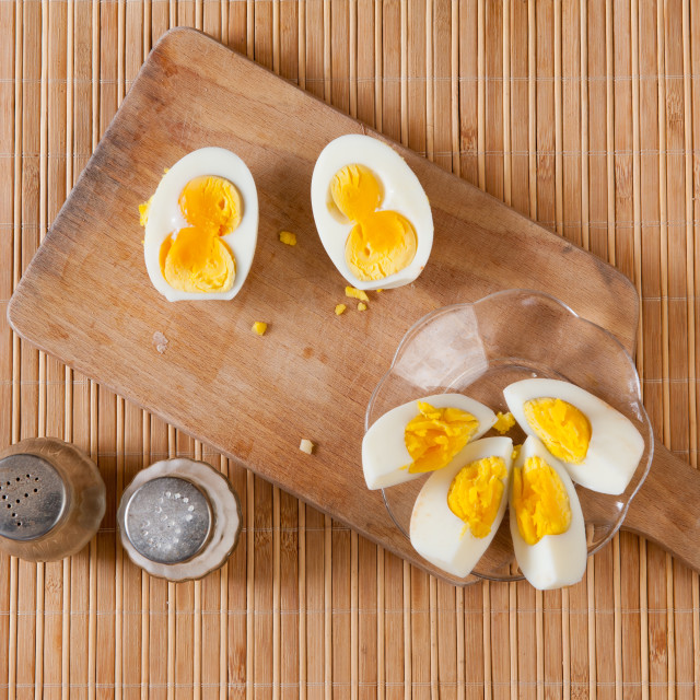 """Cut boiled two yolks egg"" stock image"