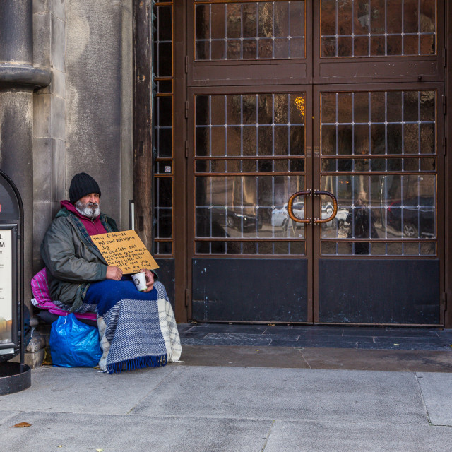"""A cathedral beggar"" stock image"