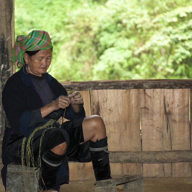 """""""Hmong woman spins the thread at her wooden house in Sa pa"""" stock image"""