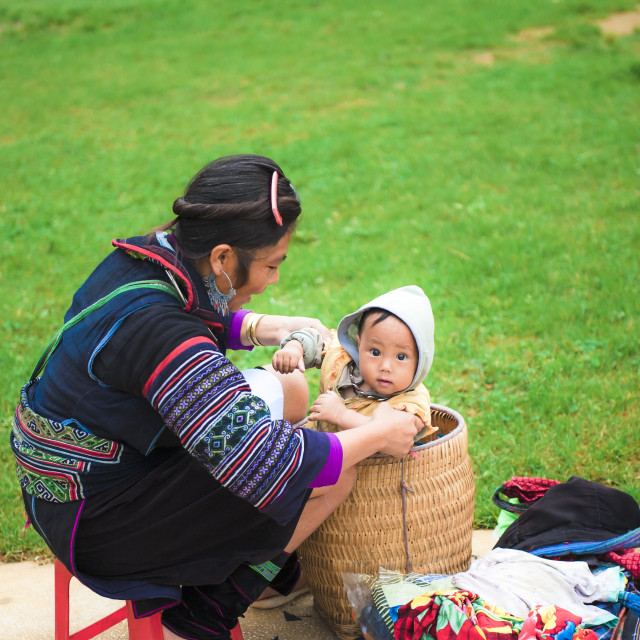 """Hmong mother and her baby at the Sa pa market"" stock image"