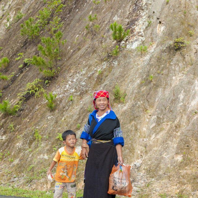 """Hmong woman and her son walks on the mountan road in Sa Pa"" stock image"