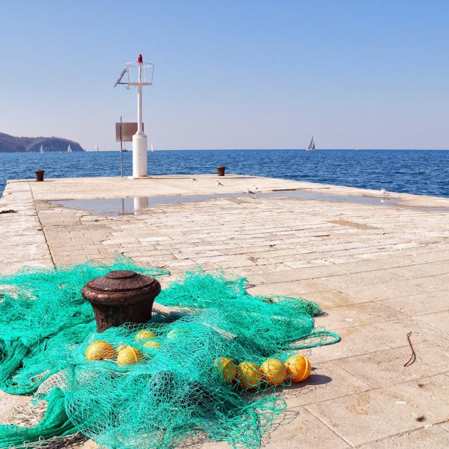 """Fishingnets on the pier"" stock image"