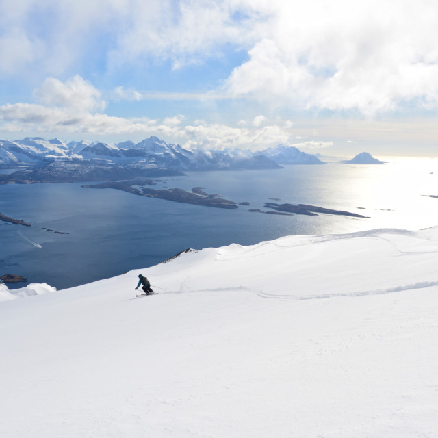 """Skiing down a mountain over the sea"" stock image"