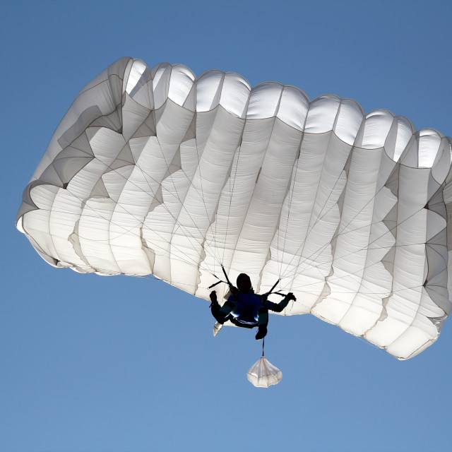 """parachutist on blue sky extreme sport"" stock image"