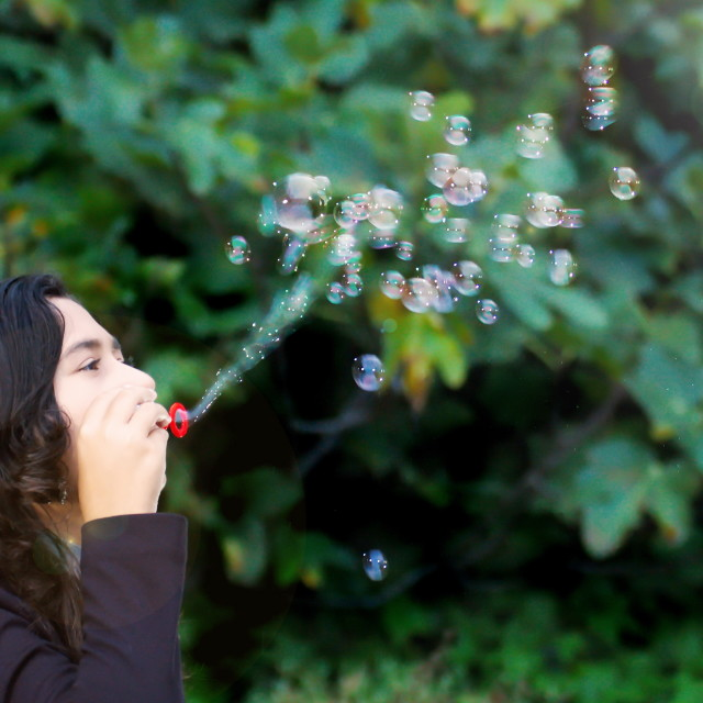 """""""Girl making bubbles"""" stock image"""