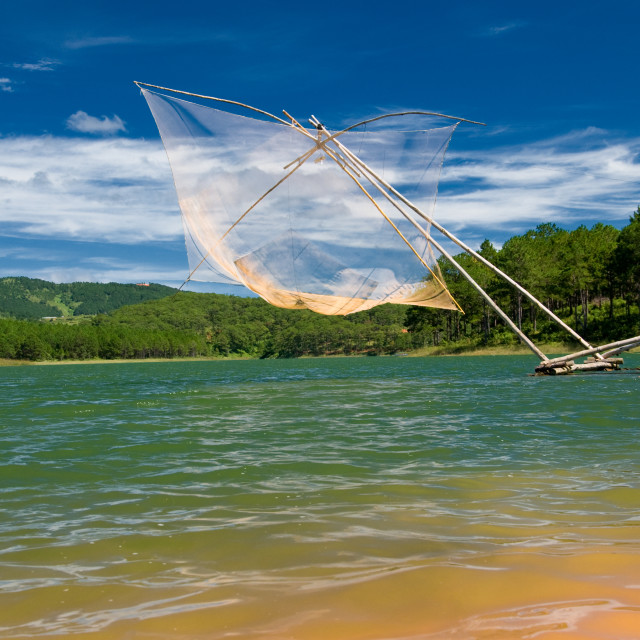 """Fish net on lake"" stock image"