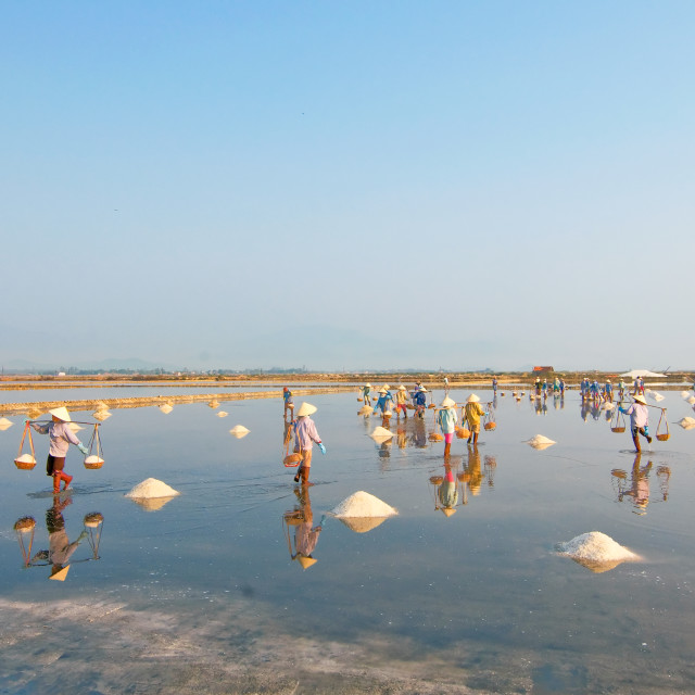"""Farmers harvest salt in Hon Khoi salt field, Nha Trang, Vietnam"" stock image"