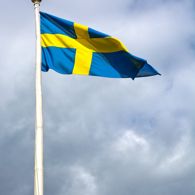 """Swedish flag against storm gray"" stock image"