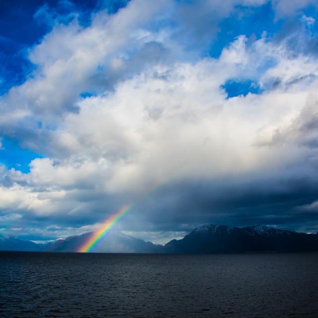 """Rainbow at sea"" stock image"
