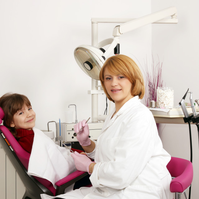 """dentist and little girl in dentist office"" stock image"