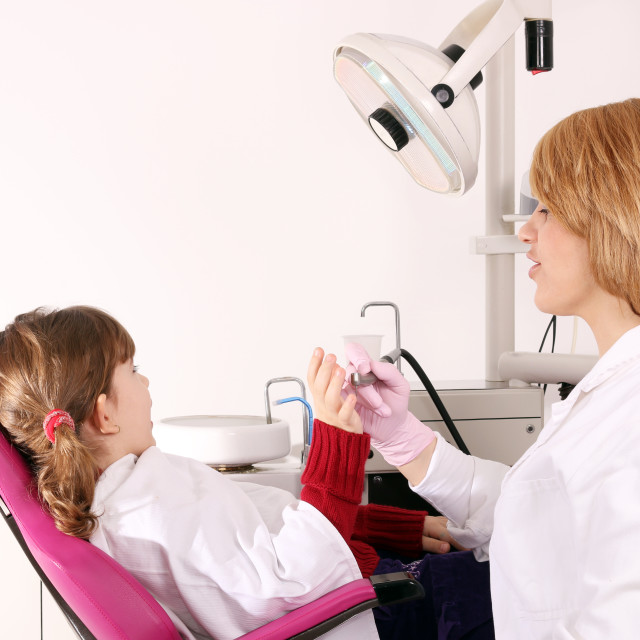 """scared little girl and dentist"" stock image"
