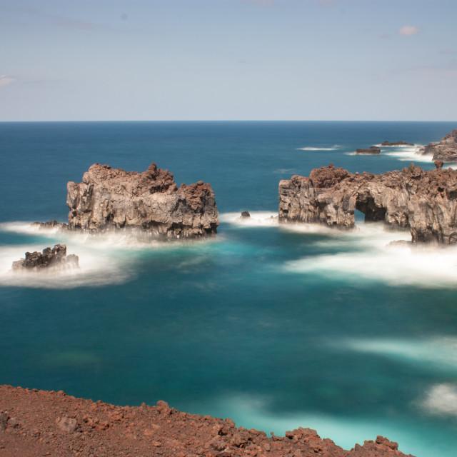 """Volcanic seascape"" stock image"