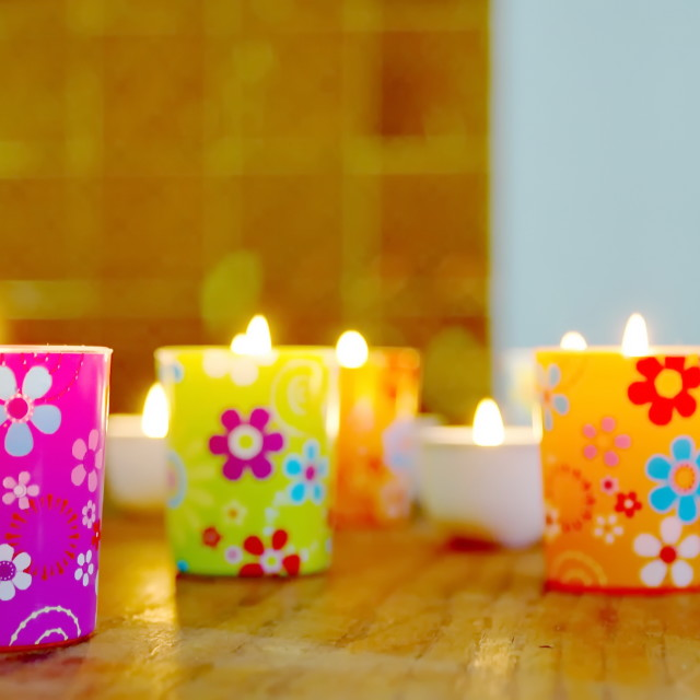 """""""Colored glass with flowers and burning candles"""" stock image"""