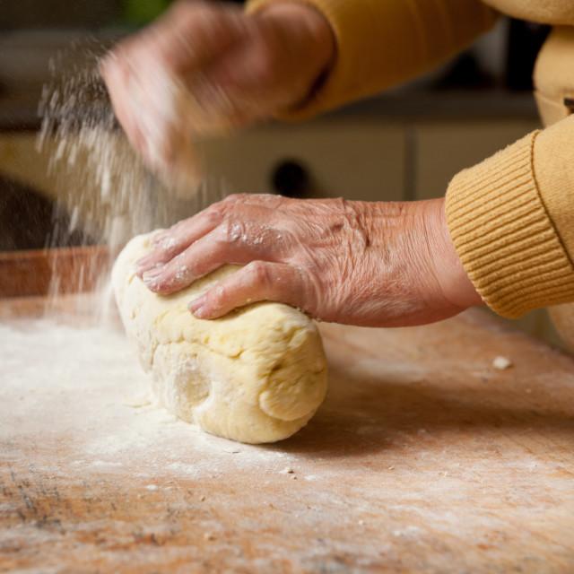 """Woman preparing kopytka dough"" stock image"