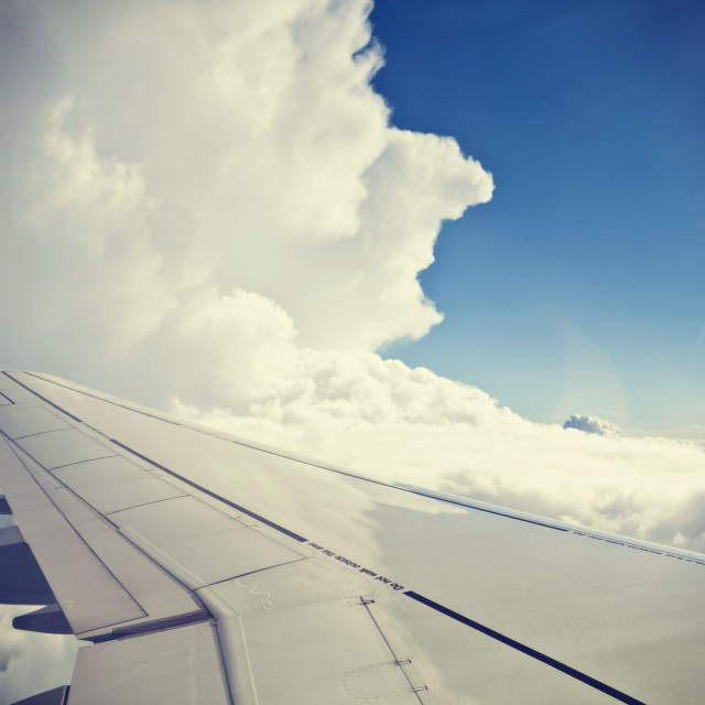 """CLOUD 9? Blue sky and white clouds, aerial view"" stock image"