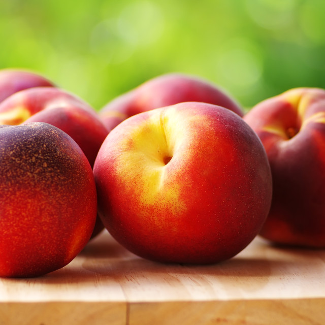 """Ripe peachs on table"" stock image"