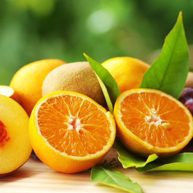 """Orange, peach and kiwi sliced fruits"" stock image"
