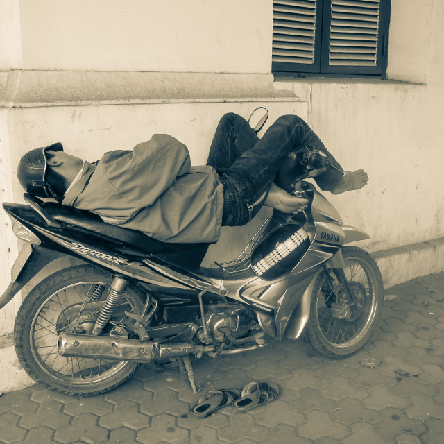 """Sleeping On His Motorbike"" stock image"