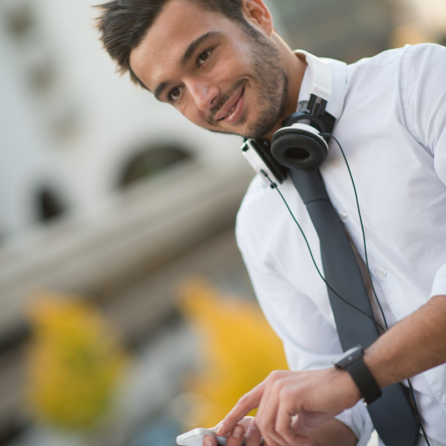 """Businessman using phone outdoor in the city"" stock image"