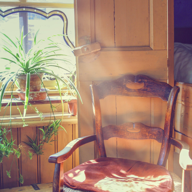 """Sunbeams inside a vintage room"" stock image"