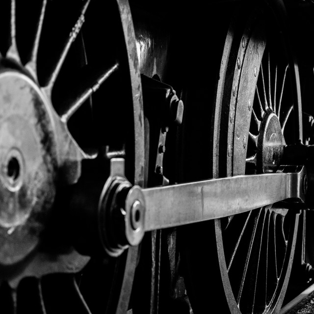 """Monochrome Close Up of Steam Engine Wheels"" stock image"