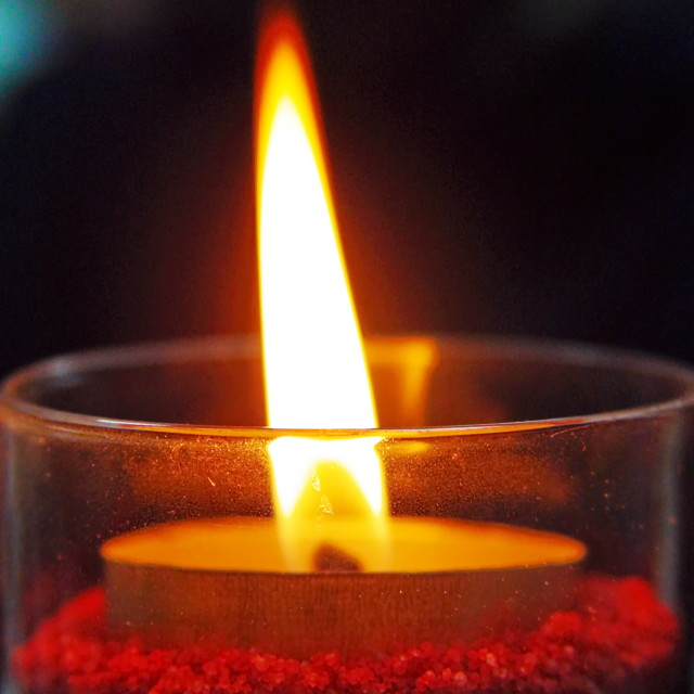 """""""Candle burning in the dark"""" stock image"""