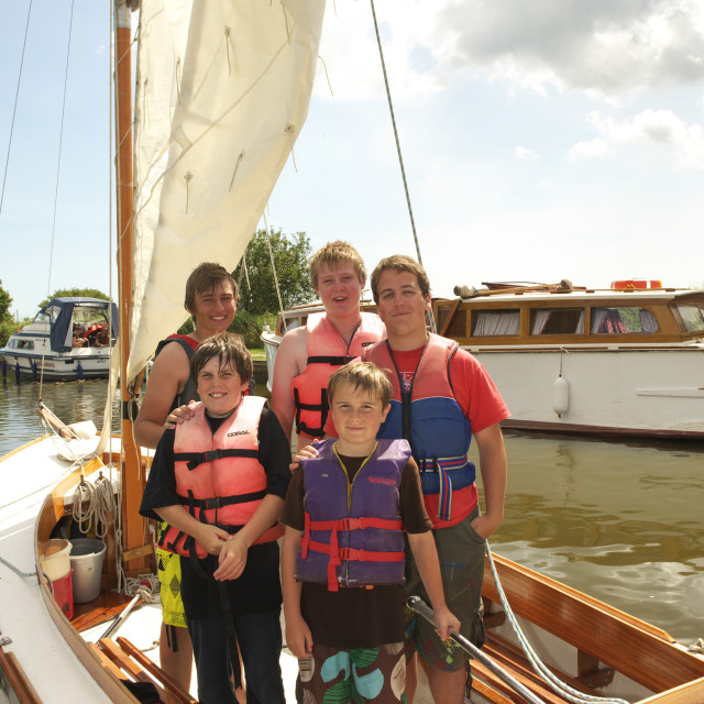 """Children sailing on the Norfolk Broads"" stock image"