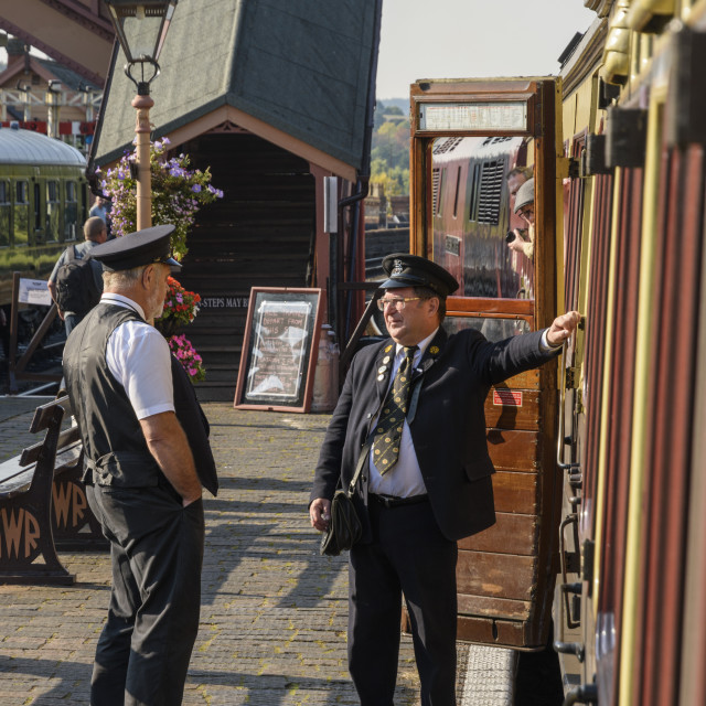 """Train guards talking"" stock image"