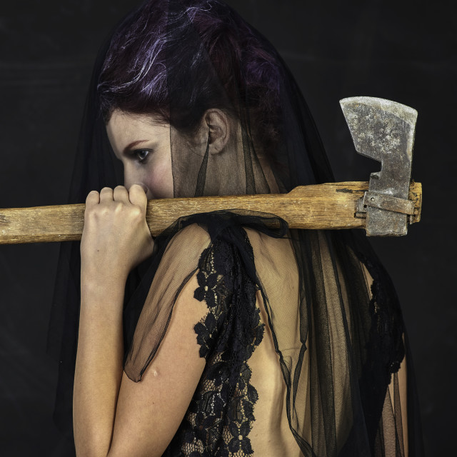 """Mourning Widow with Axe - Back"" stock image"