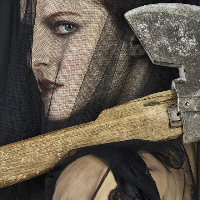 """Mourning Widow with Axe - Close-up"" stock image"