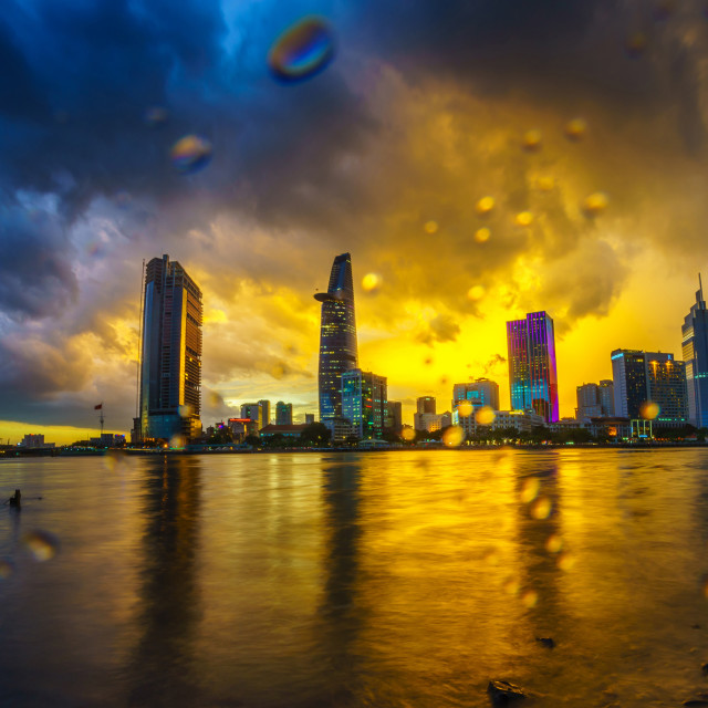 """Saigon riverside sunset in the rain"" stock image"