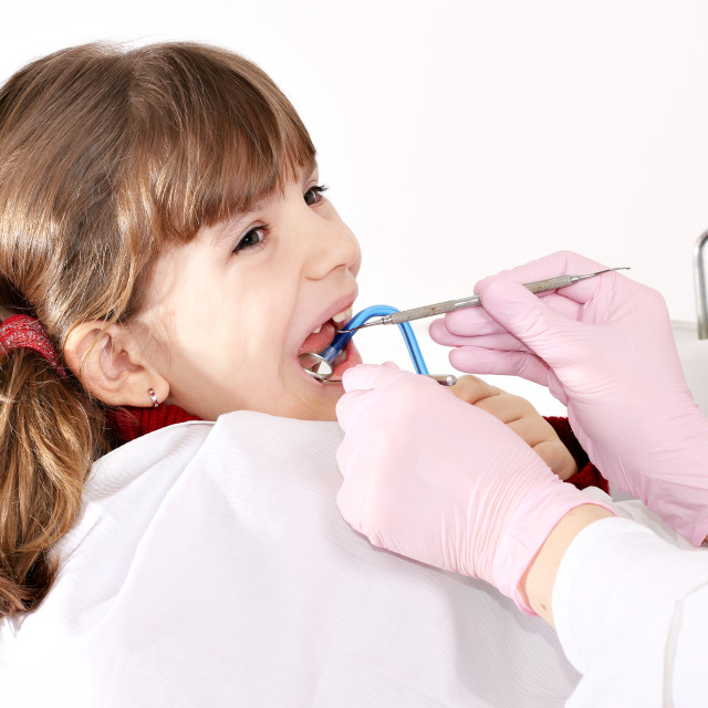 """little girl patient dental exam"" stock image"