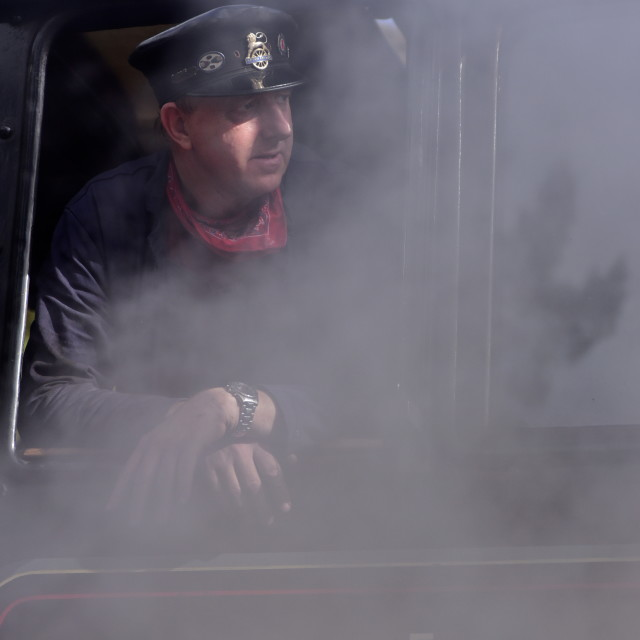 """Steam engine driver"" stock image"