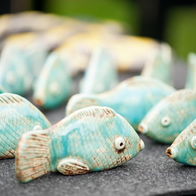 """Tiny fish ceramic decorations"" stock image"