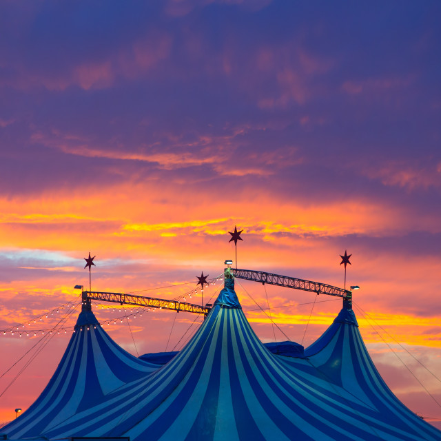 """""""Circus tent in a dramatic sunset sky colorful"""" stock image"""