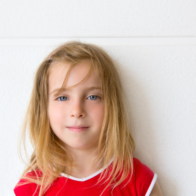"""""""Blond beautiful kid girl smiling on white wall"""" stock image"""