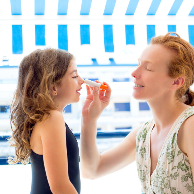 """""""children girl with mother applying sunscreen"""" stock image"""