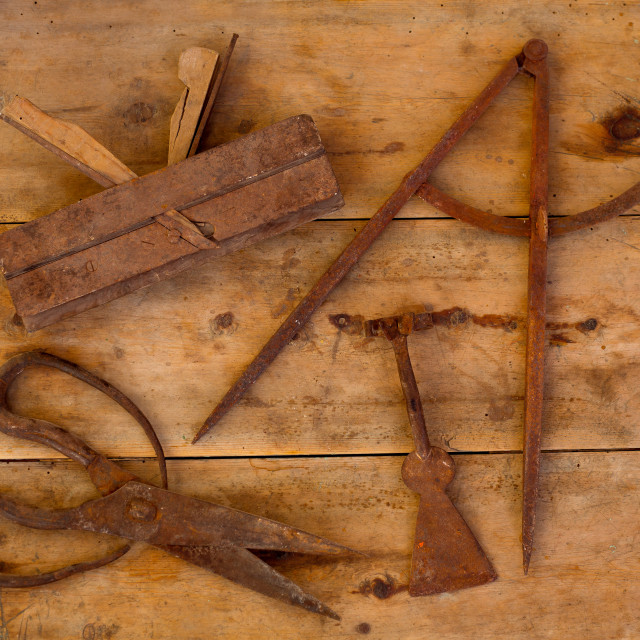 """Aged tools wood planer wool scissors drawing compass"" stock image"
