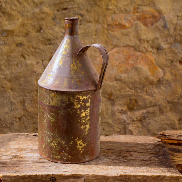 """Antique rusted iron jar with aged brass on vintage wood"" stock image"
