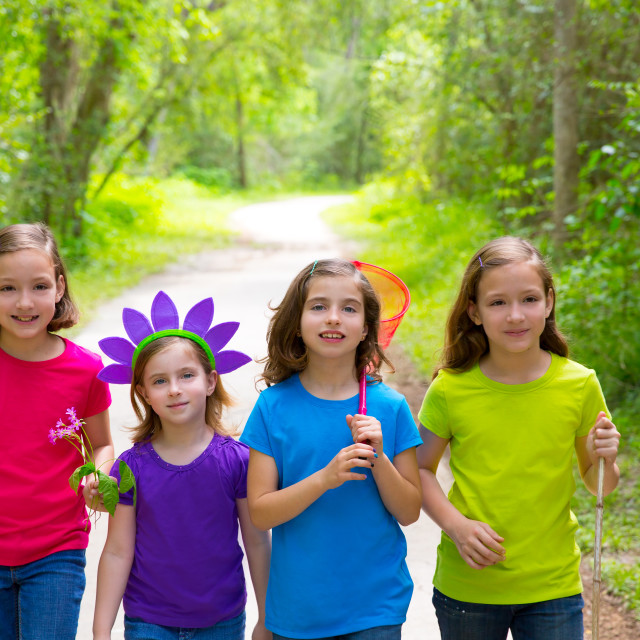 """Friends and sister girls walking outdoor in forest track"" stock image"