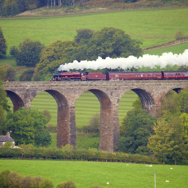 """Steam train on viaduct"" stock image"