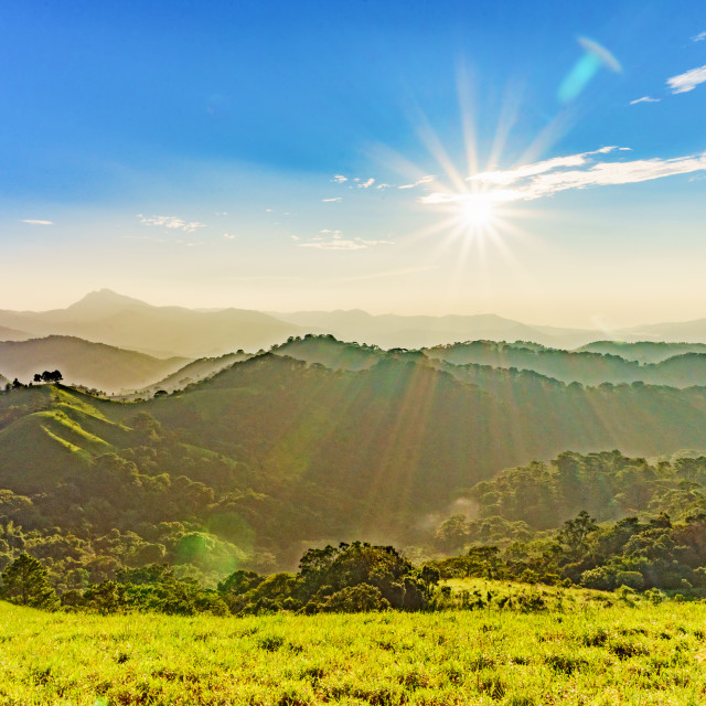 """Landscape of hills and sun"" stock image"