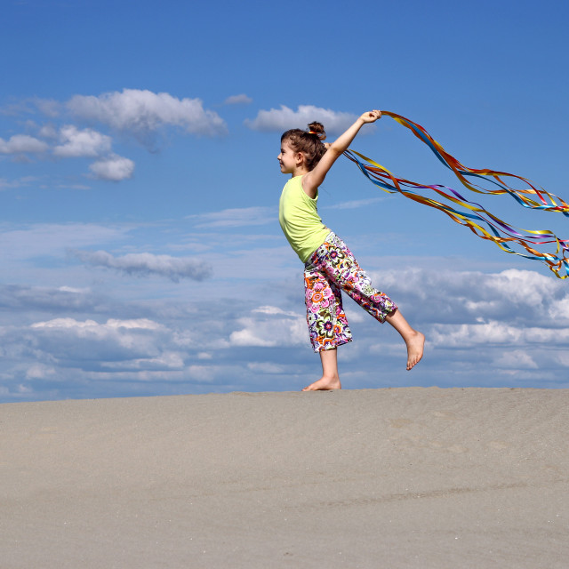 """happy little girl with colorful ribbons on beach"" stock image"
