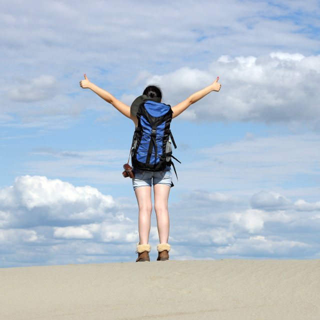 """girl hiker with thumbs up in desert"" stock image"