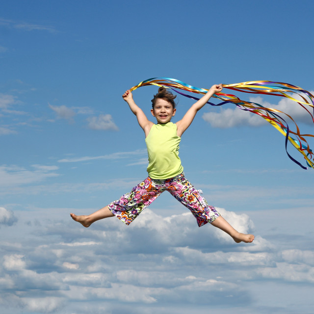 """happy little girl with colorful ribbons on blue sky"" stock image"
