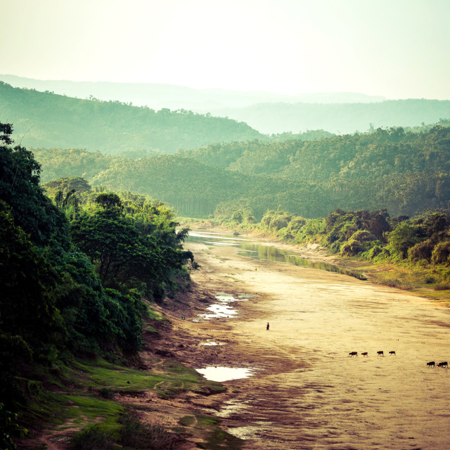 """Dusk in a Bangladeshi river bed"" stock image"