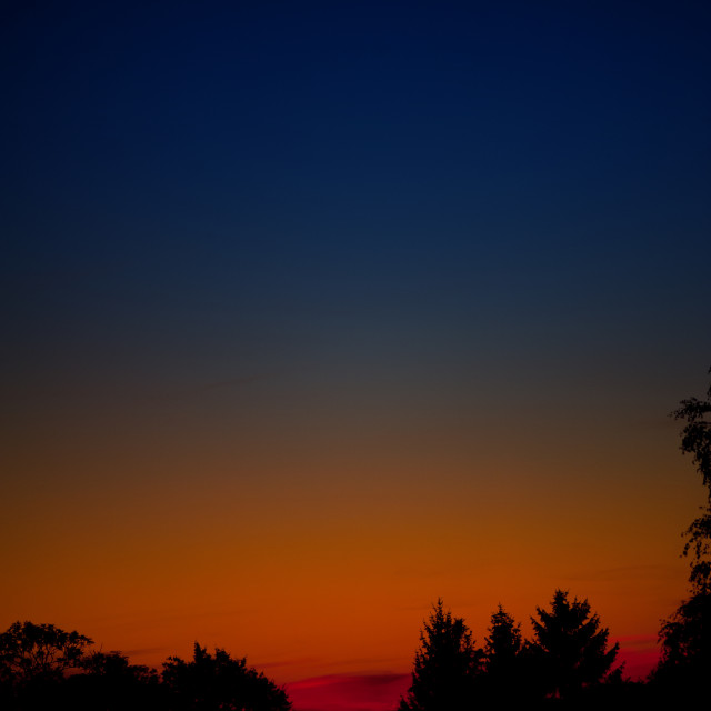 """Calming red dusk sky"" stock image"