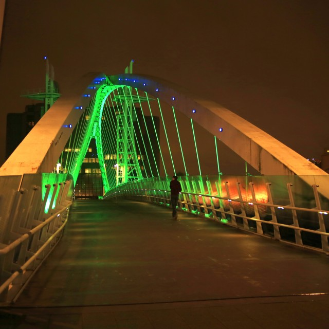 """Illuminated footbridge over the Manchester Ship Canal at night"" stock image"