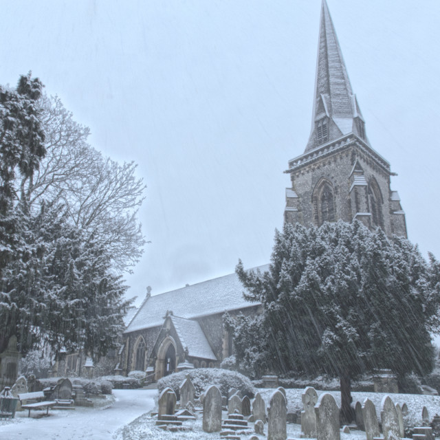 """Church and Graveyard in the Snow"" stock image"