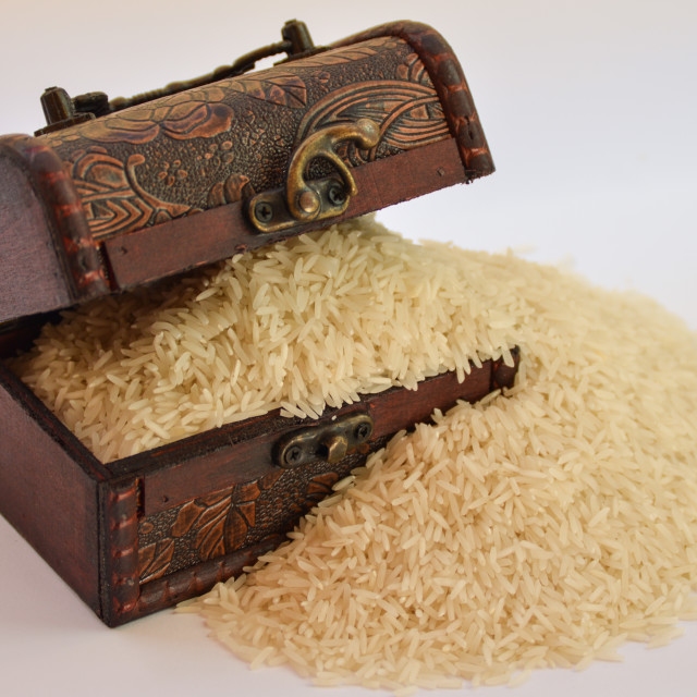 """A treasure chest with basmati rice"" stock image"